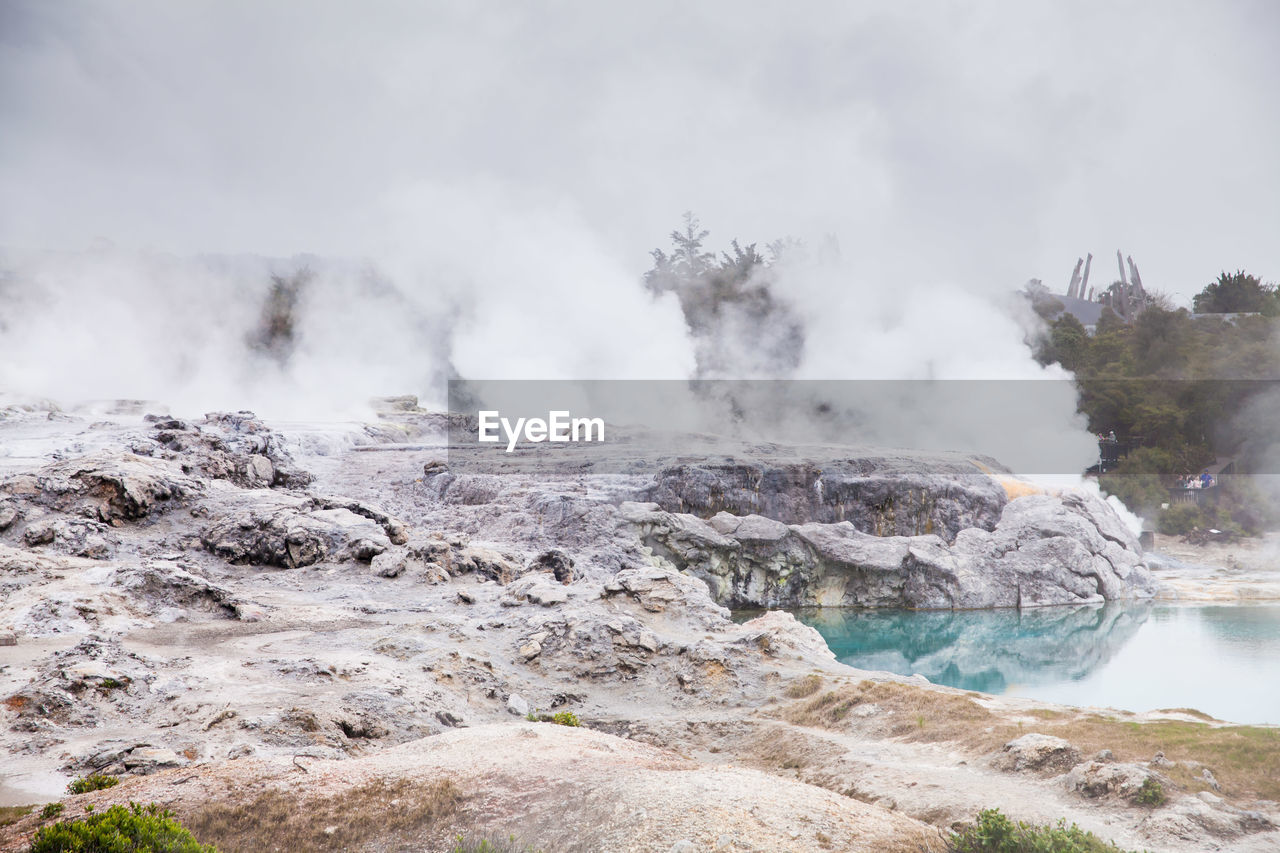 smoke - physical structure, geology, water, physical geography, beauty in nature, scenics - nature, steam, power in nature, non-urban scene, day, nature, heat - temperature, tranquil scene, power, no people, hot spring, environment, mountain, tranquility, emitting, outdoors, pollution