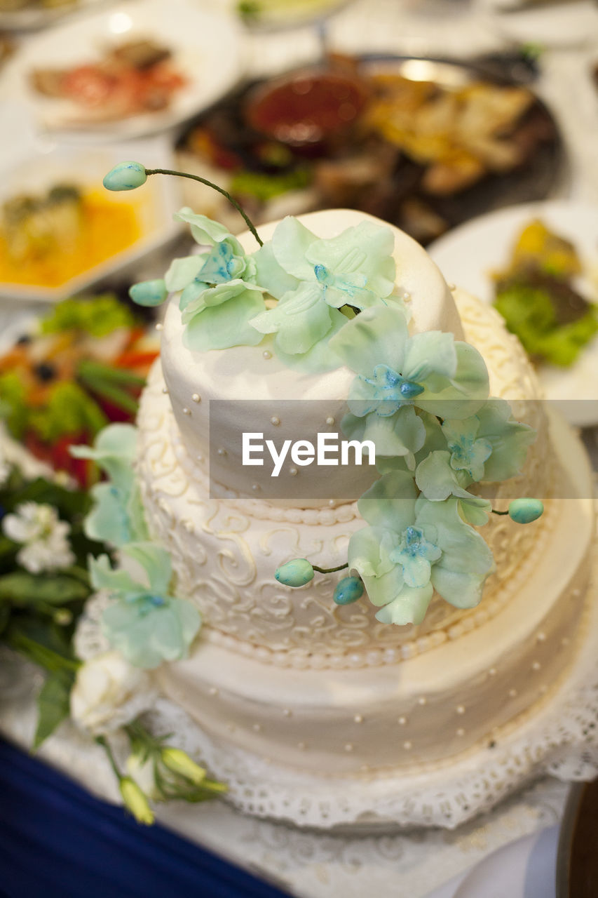 sweet food, food and drink, indulgence, dessert, food, freshness, temptation, unhealthy eating, ready-to-eat, indoors, no people, close-up, cake, table, plate, serving size, dessert topping, flower, day
