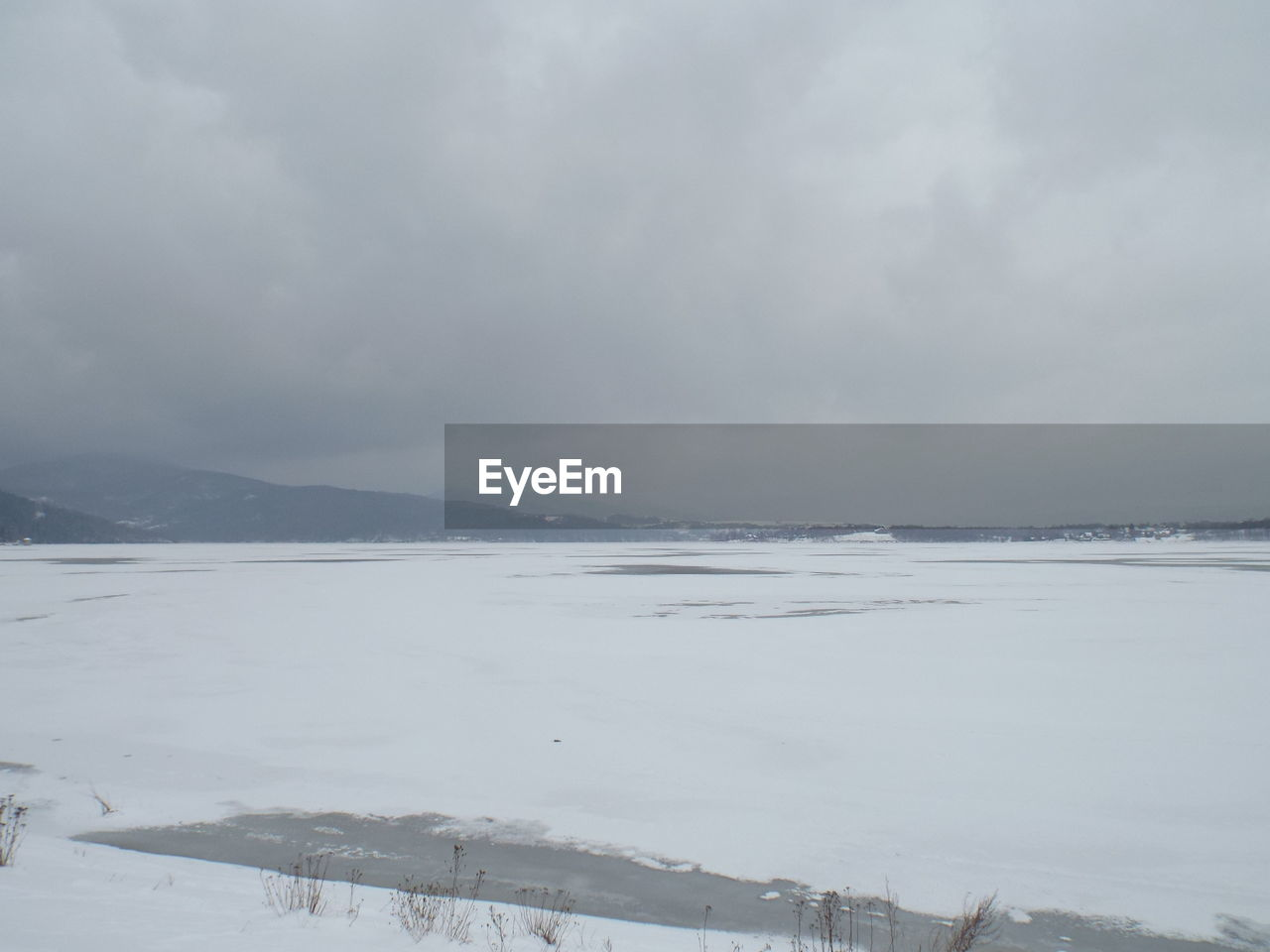 cold temperature, winter, sky, snow, beauty in nature, cloud - sky, tranquility, water, nature, tranquil scene, scenics - nature, no people, environment, day, non-urban scene, outdoors, landscape, white color