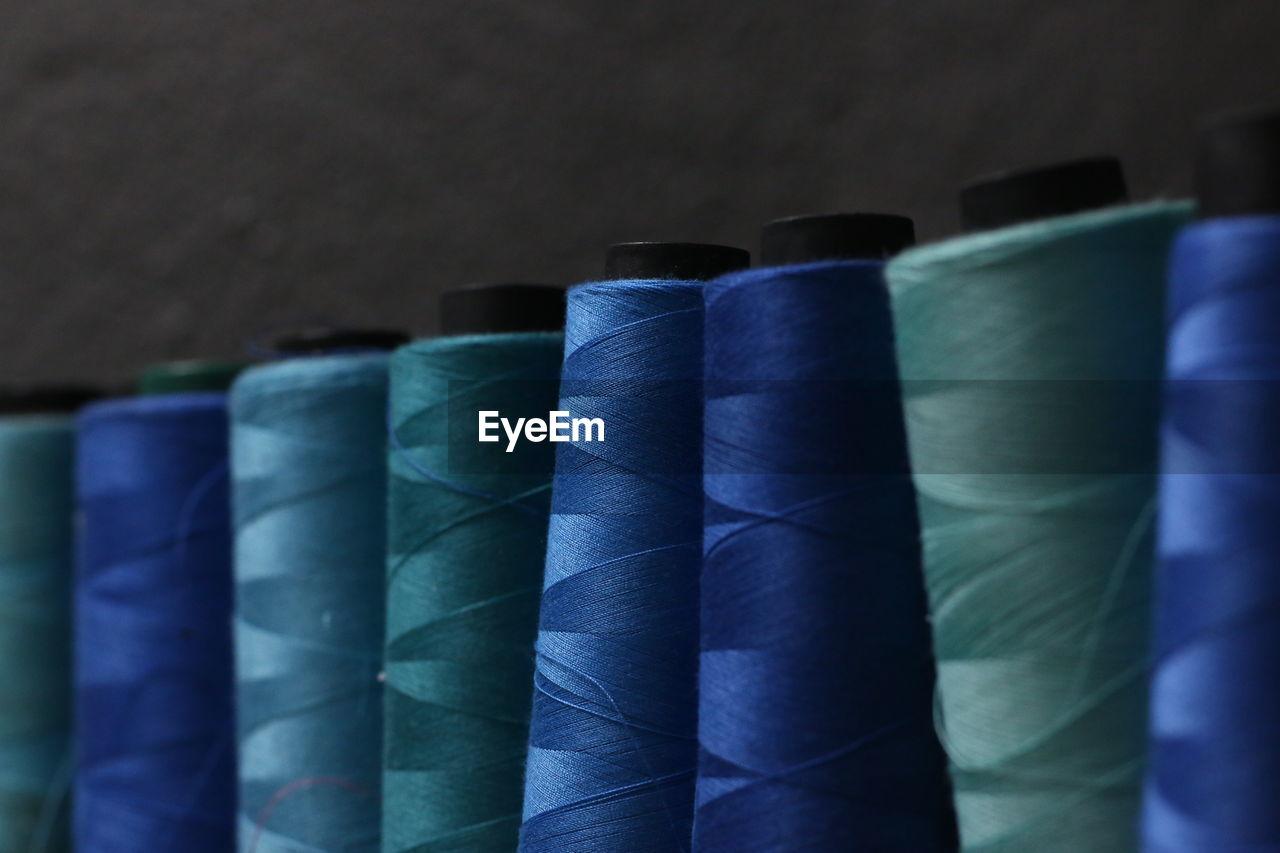 Sewing thread. blue thread.