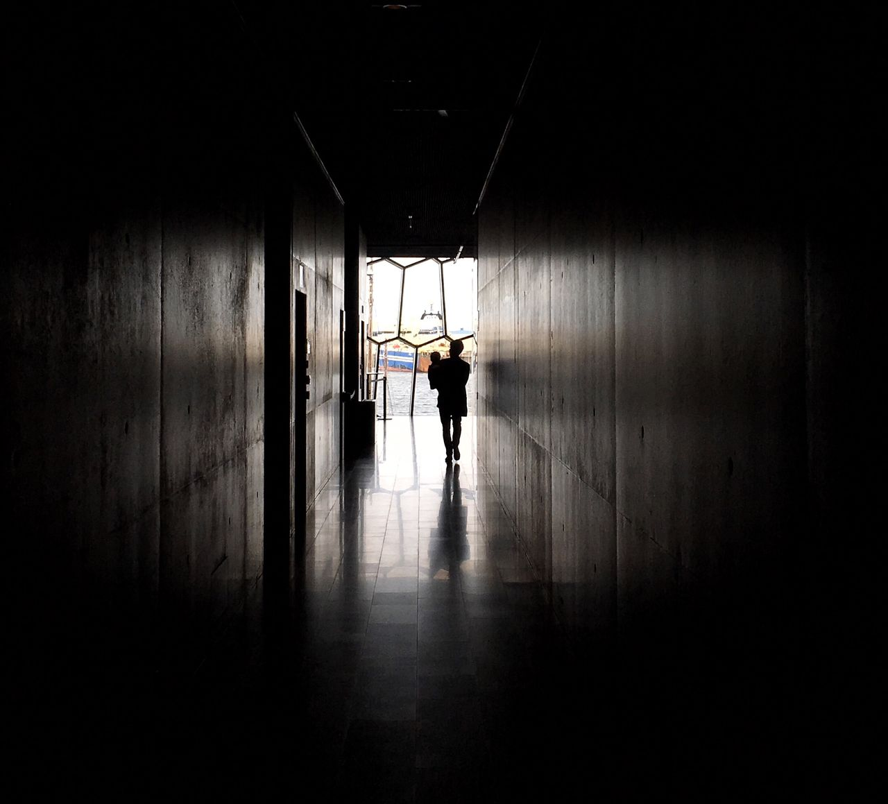 indoors, walking, corridor, one person, full length, real people, architecture, men, day, people