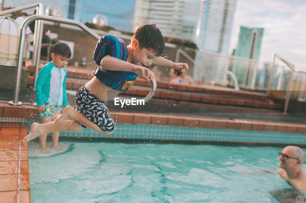 Boy Jumping In Swimming Pool