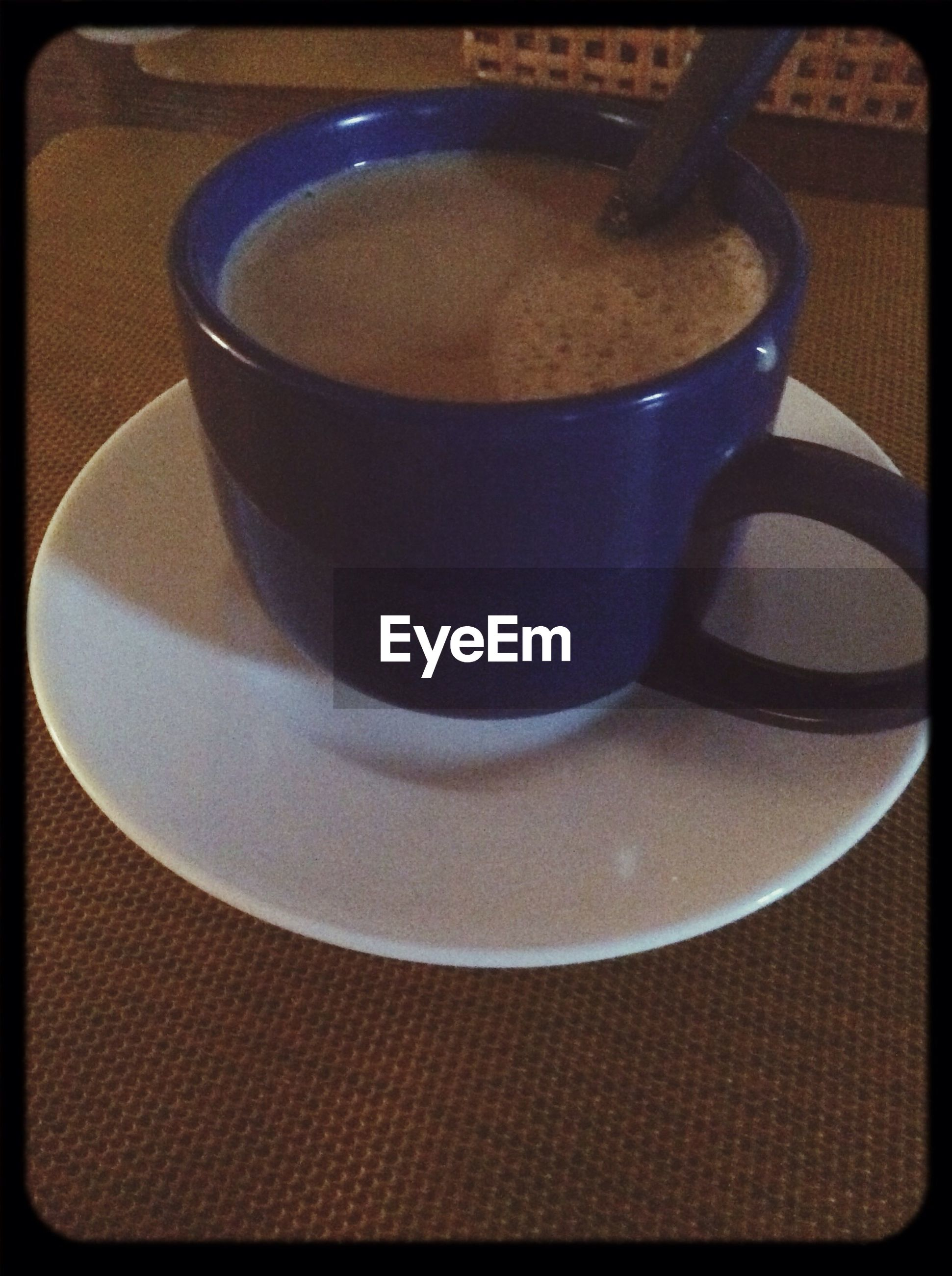 transfer print, auto post production filter, indoors, table, coffee cup, still life, close-up, drink, food and drink, high angle view, refreshment, coffee - drink, coffee, cup, no people, freshness, spoon, saucer, selective focus, frothy drink