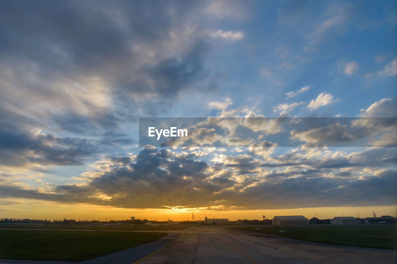 sunset, sky, cloud - sky, transportation, beauty in nature, nature, road, no people, orange color, mode of transportation, outdoors, scenics - nature, motor vehicle, dramatic sky, car, environment, the way forward, sunlight, direction