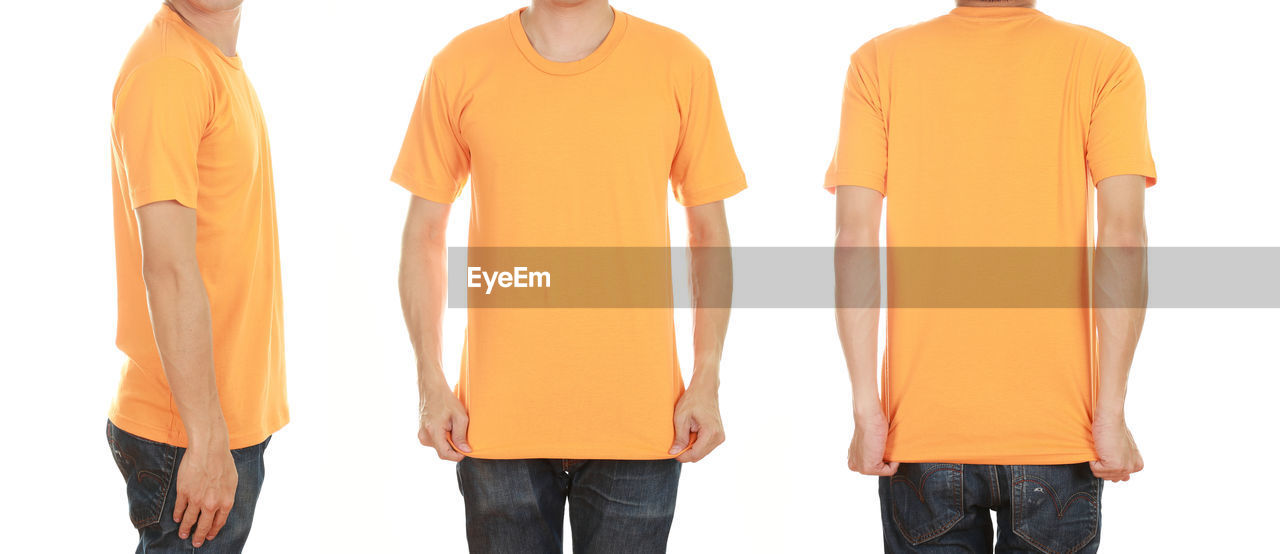 white background, indoors, studio shot, rear view, orange color, standing, casual clothing, cut out, men, women, clothing, people, three quarter length, copy space, t-shirt, adult, lifestyles, yellow, side by side, jeans, blank, teenager
