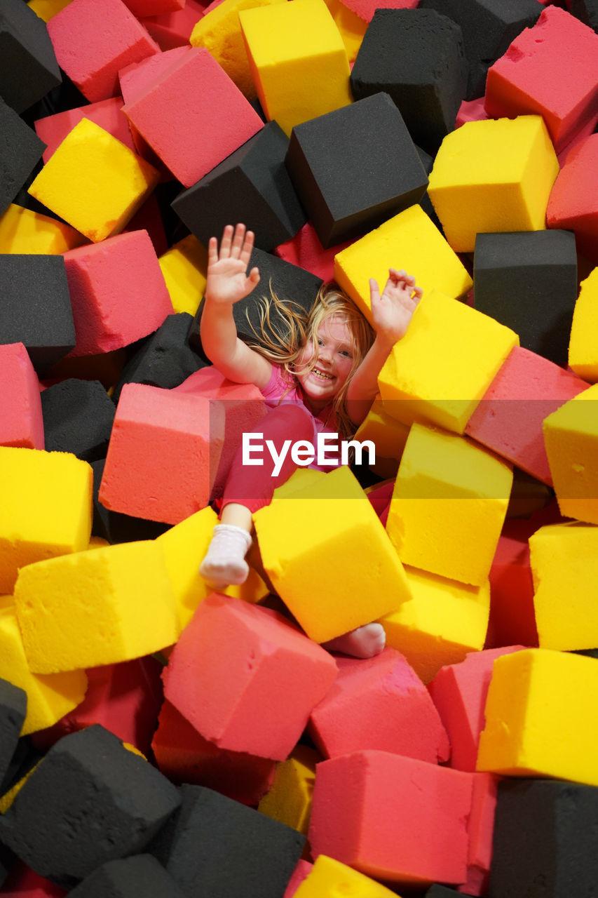 High Angle View Of Girl Lying On Sponges