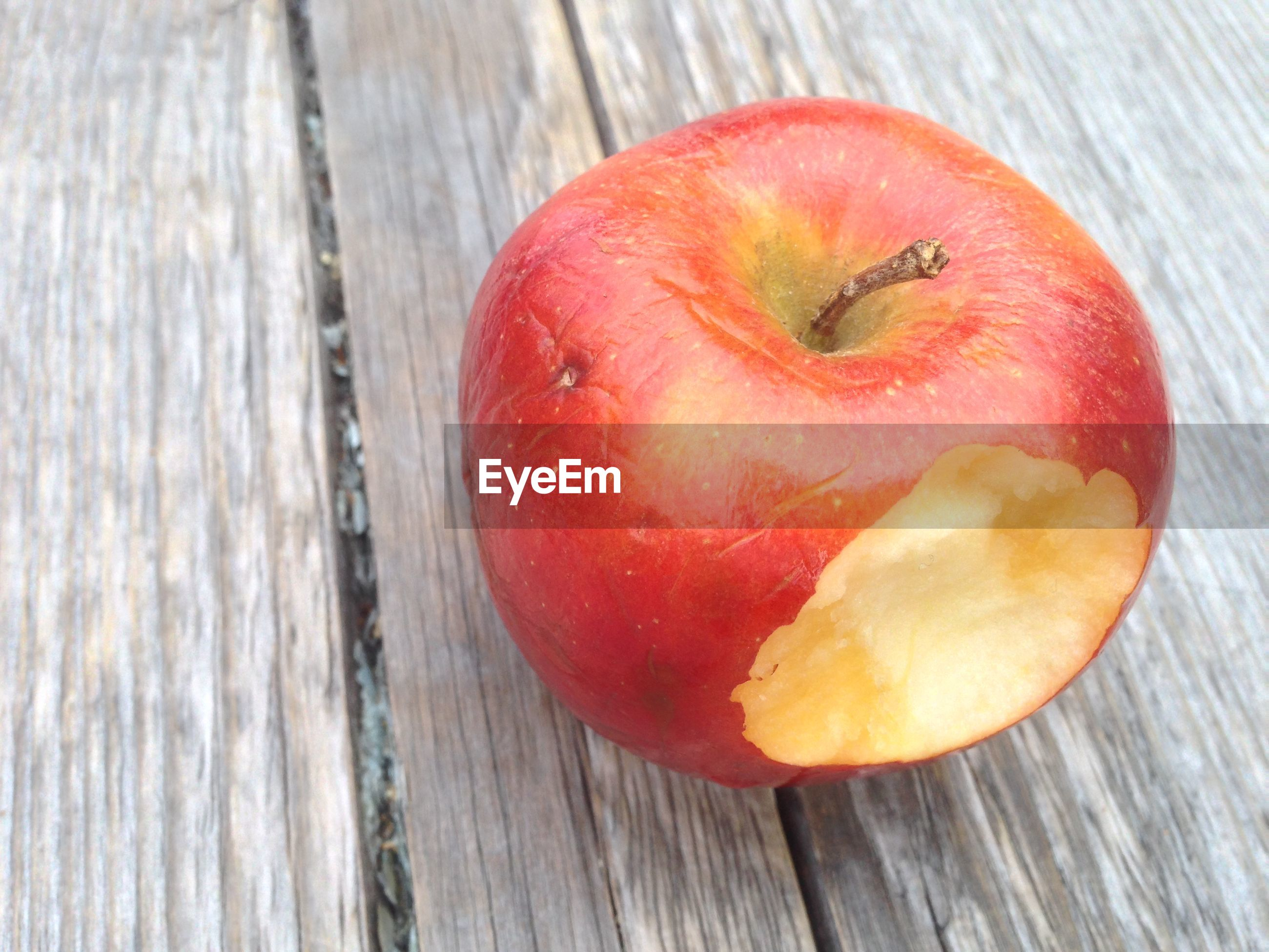 High angle view of eaten apple on table