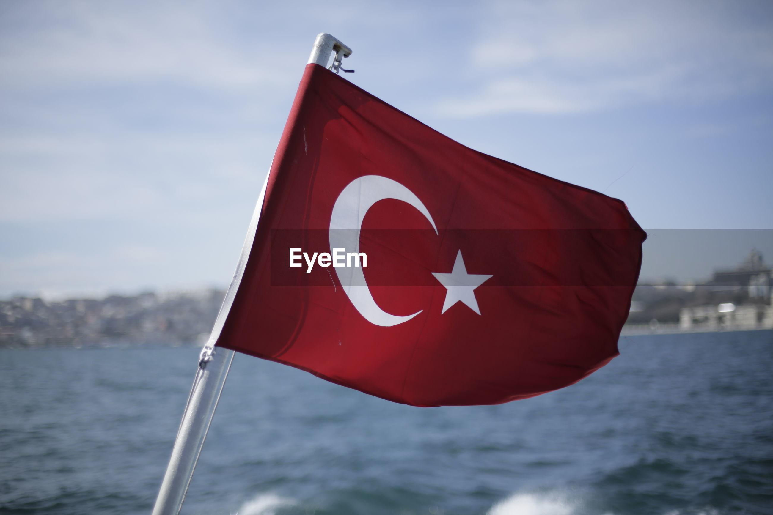 Turkish flag on boat at bosphorus