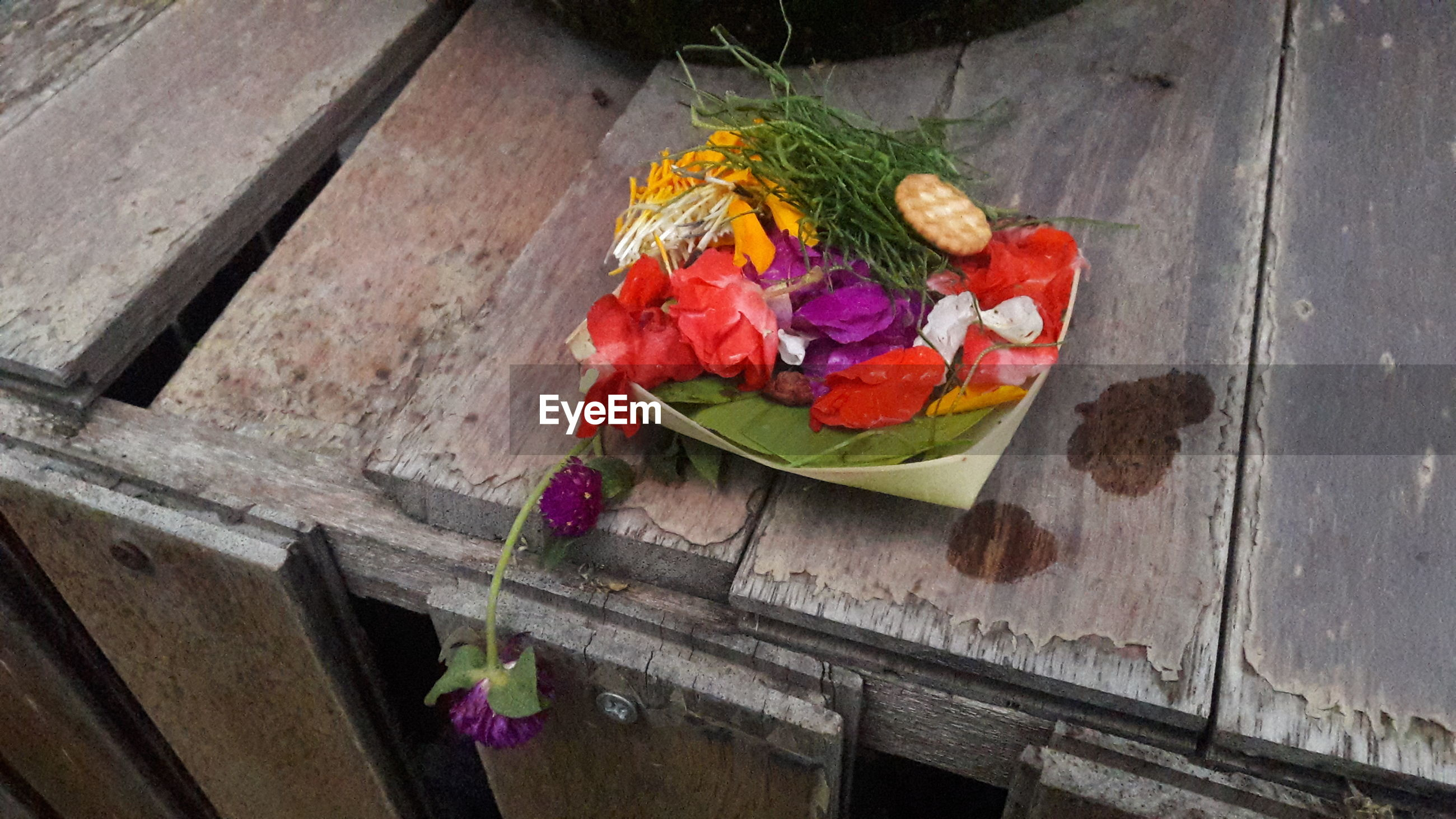 High angle view of religious offerings on wooden planks