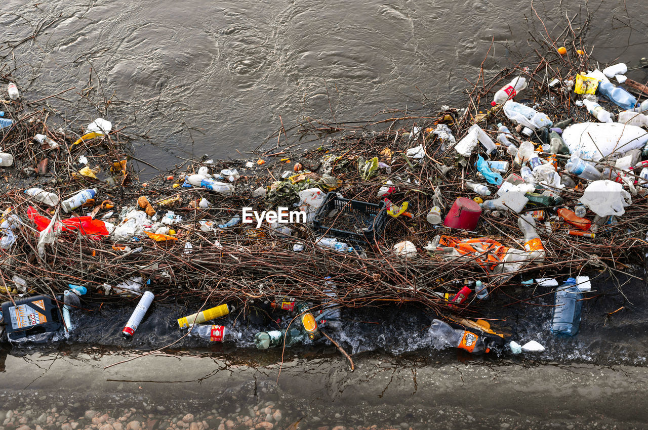 GARBAGE IN RIVER WITH UMBRELLA