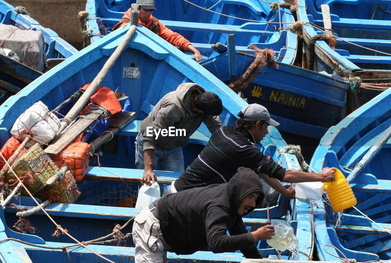 real people, occupation, nautical vessel, day, working, men, outdoors, industry, standing, togetherness, protective workwear, manual worker, teamwork, drilling rig, people