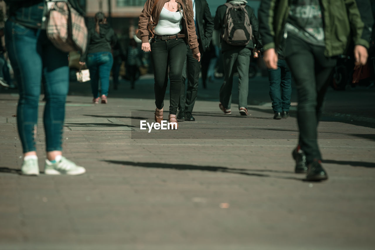 group of people, low section, real people, city, women, human leg, walking, selective focus, street, adult, human body part, day, lifestyles, people, crowd, body part, men, incidental people, sunlight, government, human foot