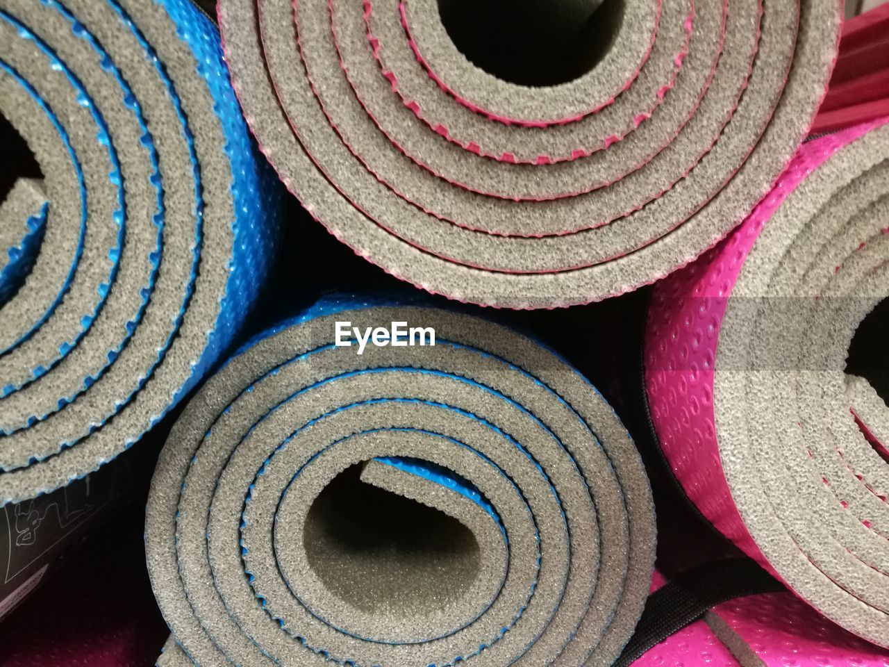 rolled up, stack, full frame, textile, indoors, spool, no people, roll, backgrounds, close-up, day