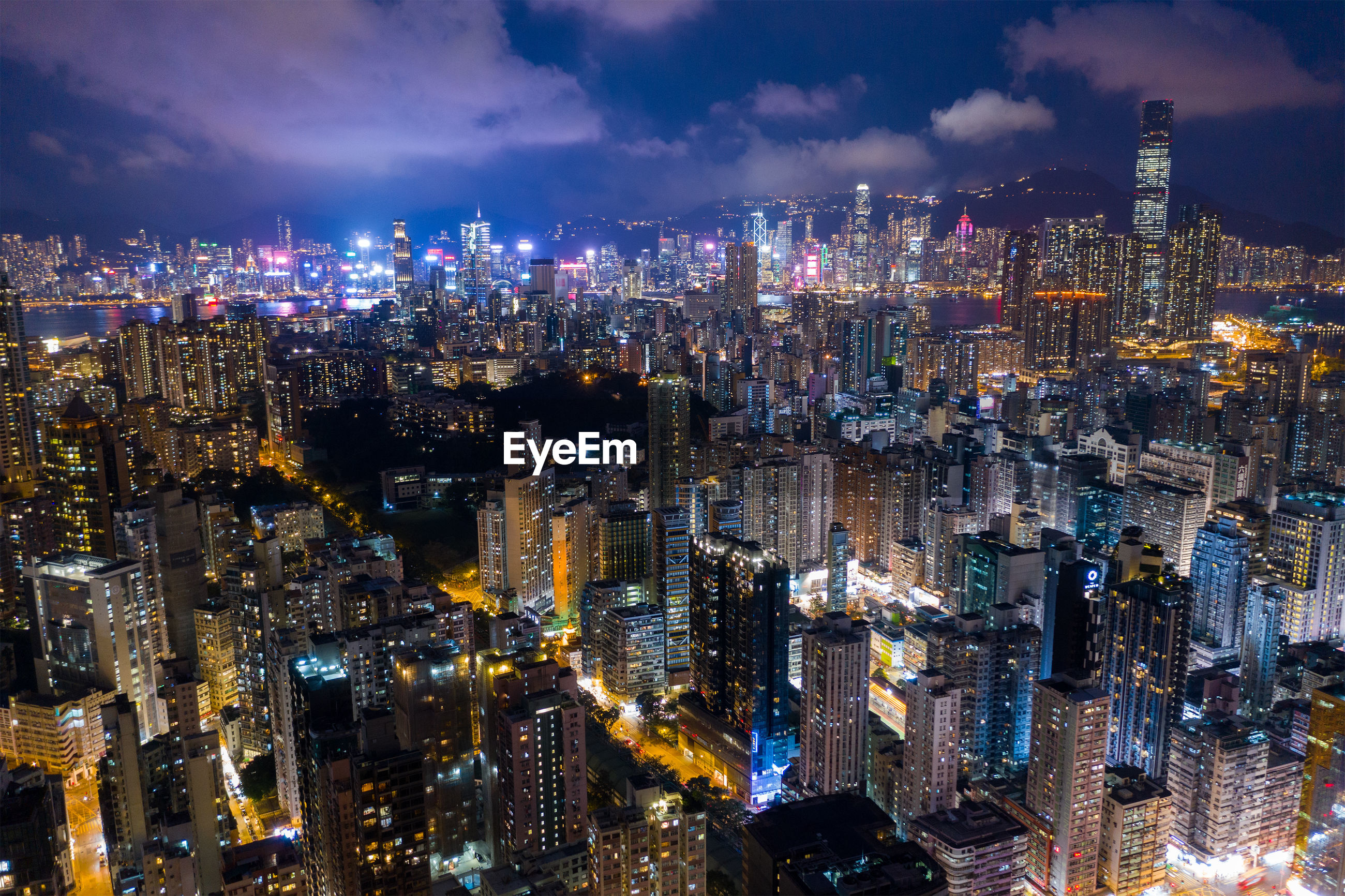 Aerial view of modern buildings in city at night