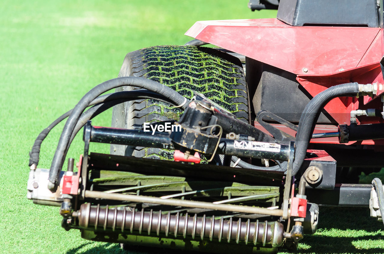 CLOSE-UP OF TRACTOR IN FIELD