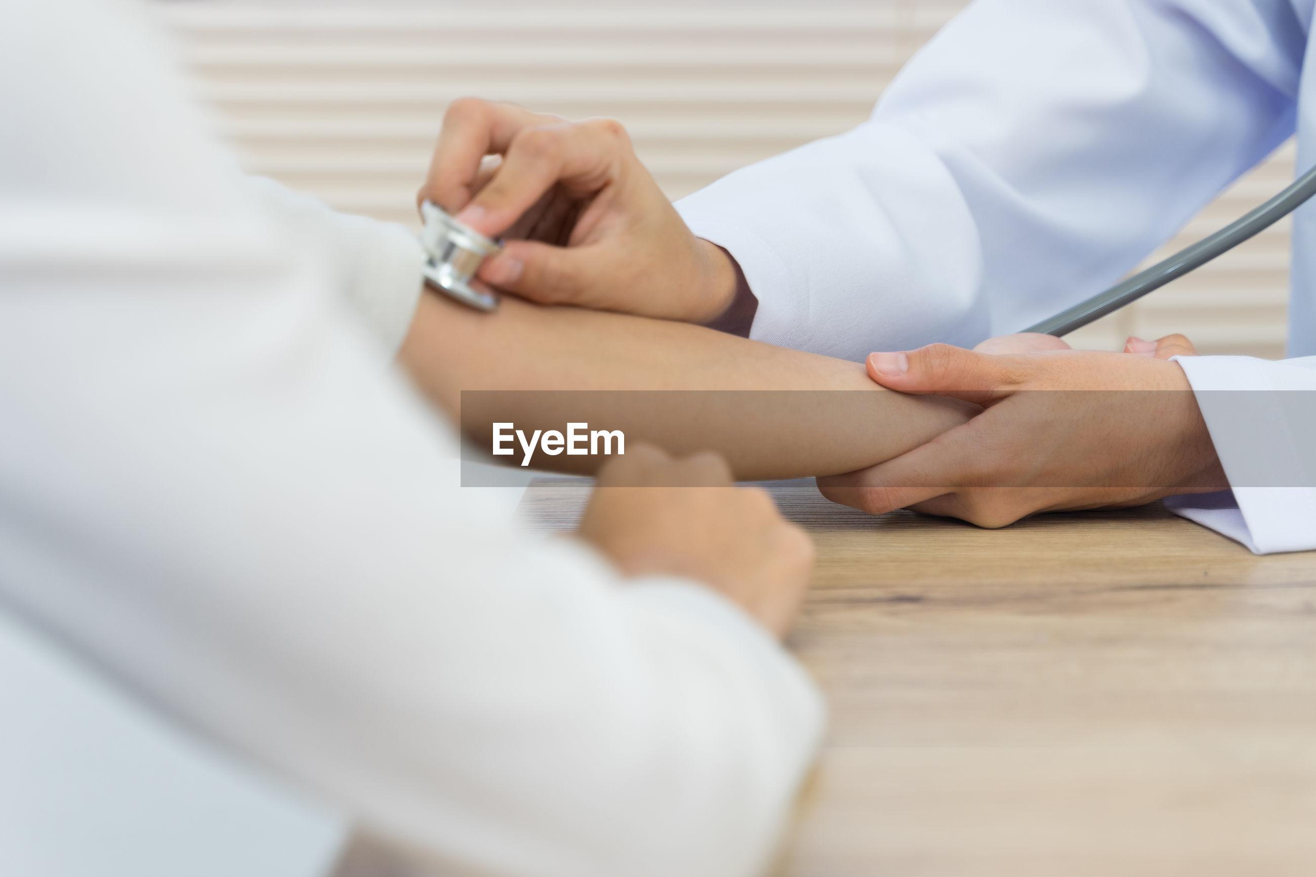 Doctor examining patient in hospital