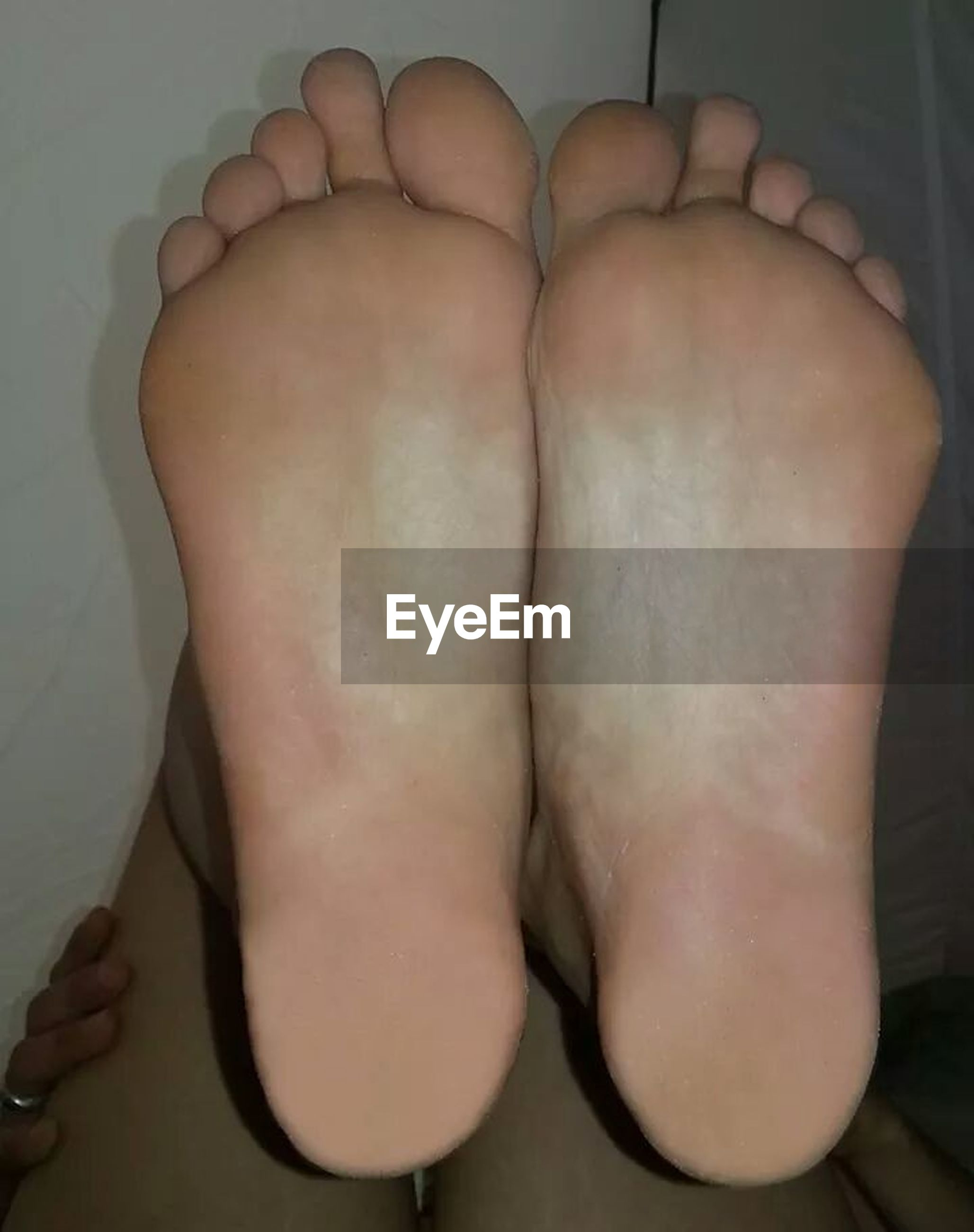 indoors, person, lifestyles, part of, leisure activity, cropped, human finger, home interior, men, holding, close-up, high angle view, low section, barefoot, human foot