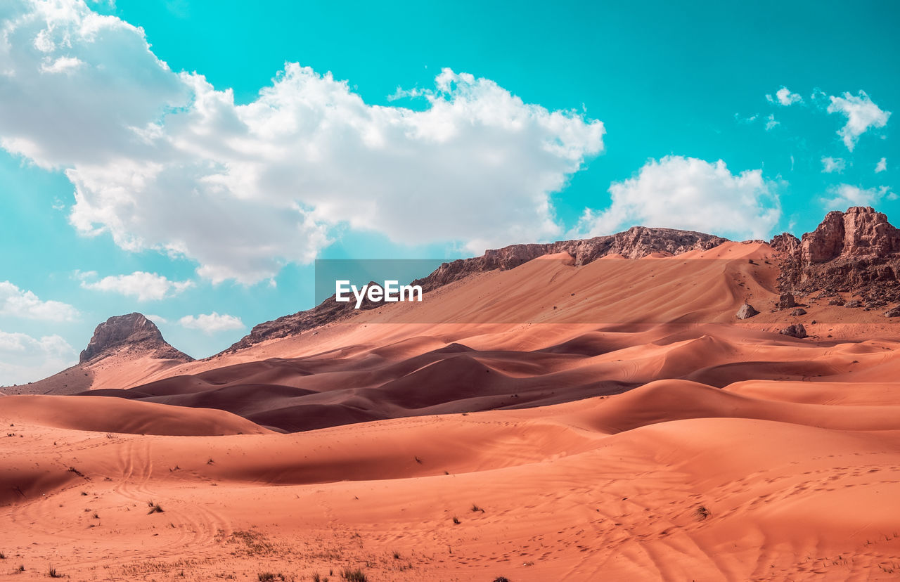 scenics - nature, cloud - sky, sky, beauty in nature, tranquil scene, landscape, non-urban scene, desert, environment, tranquility, climate, arid climate, remote, land, no people, sand, sand dune, nature, day, idyllic, eroded, atmospheric
