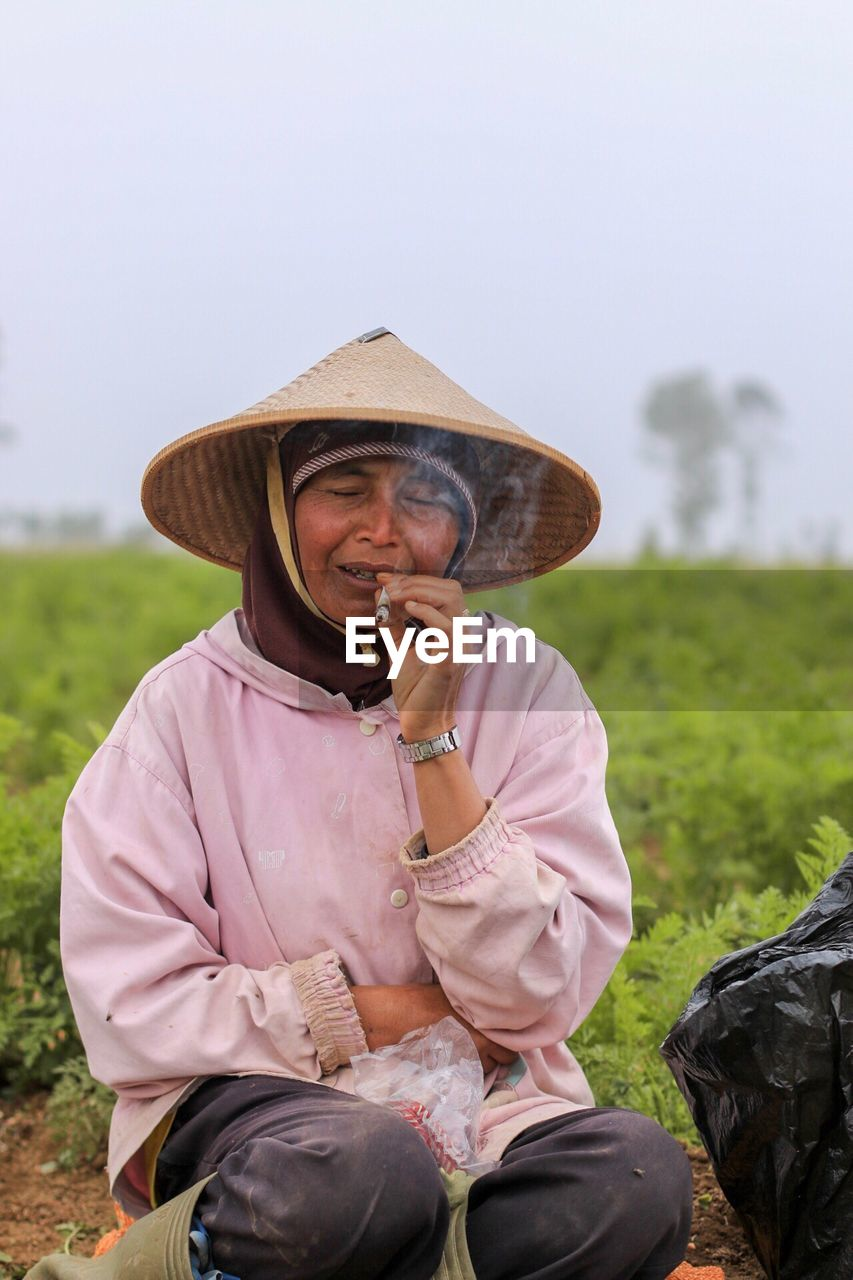 Mature Woman Smoking Marijuana Joint At Farm