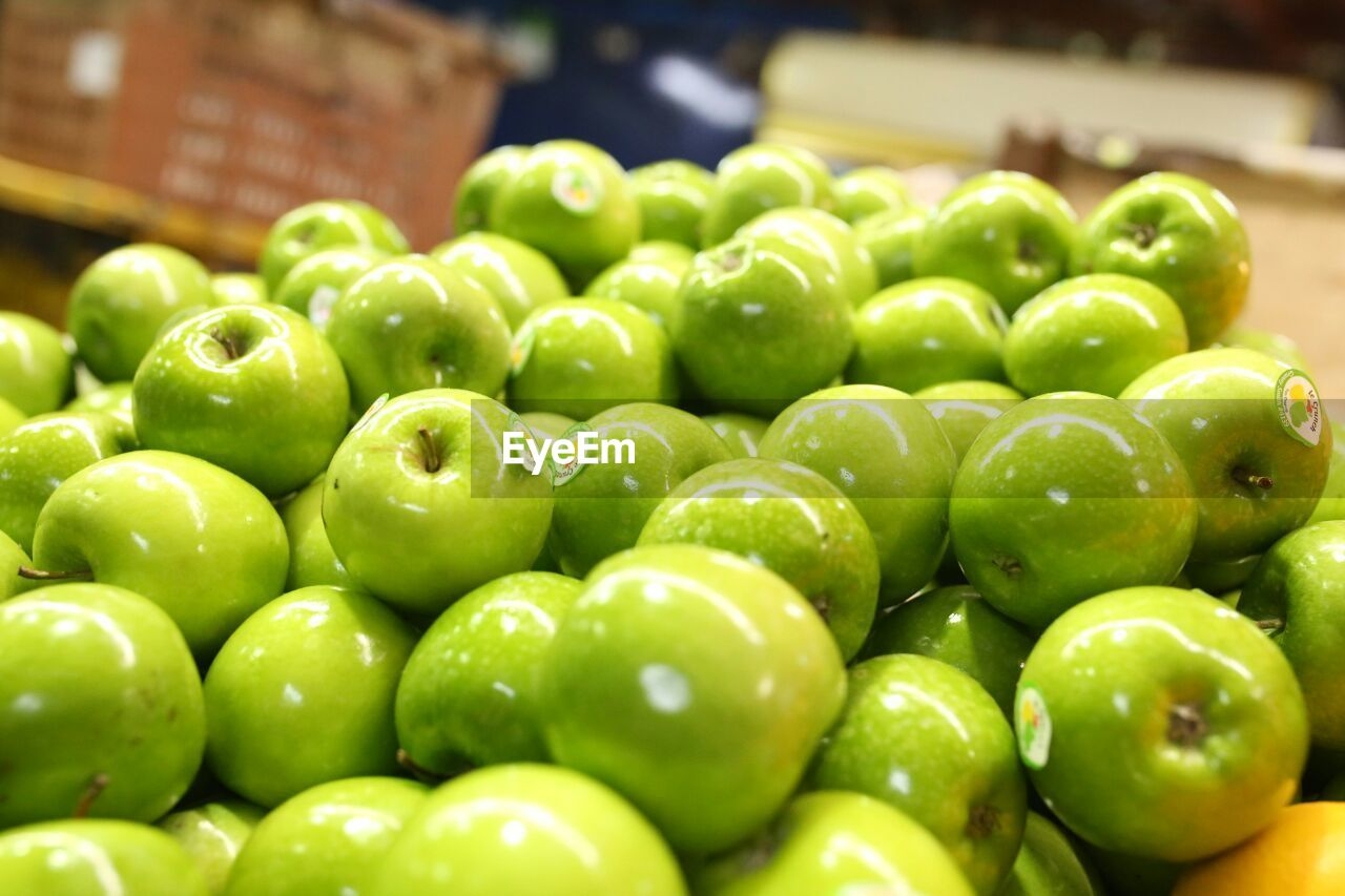 green color, abundance, healthy eating, large group of objects, freshness, food, food and drink, fruit, no people, close-up, indoors, market, day