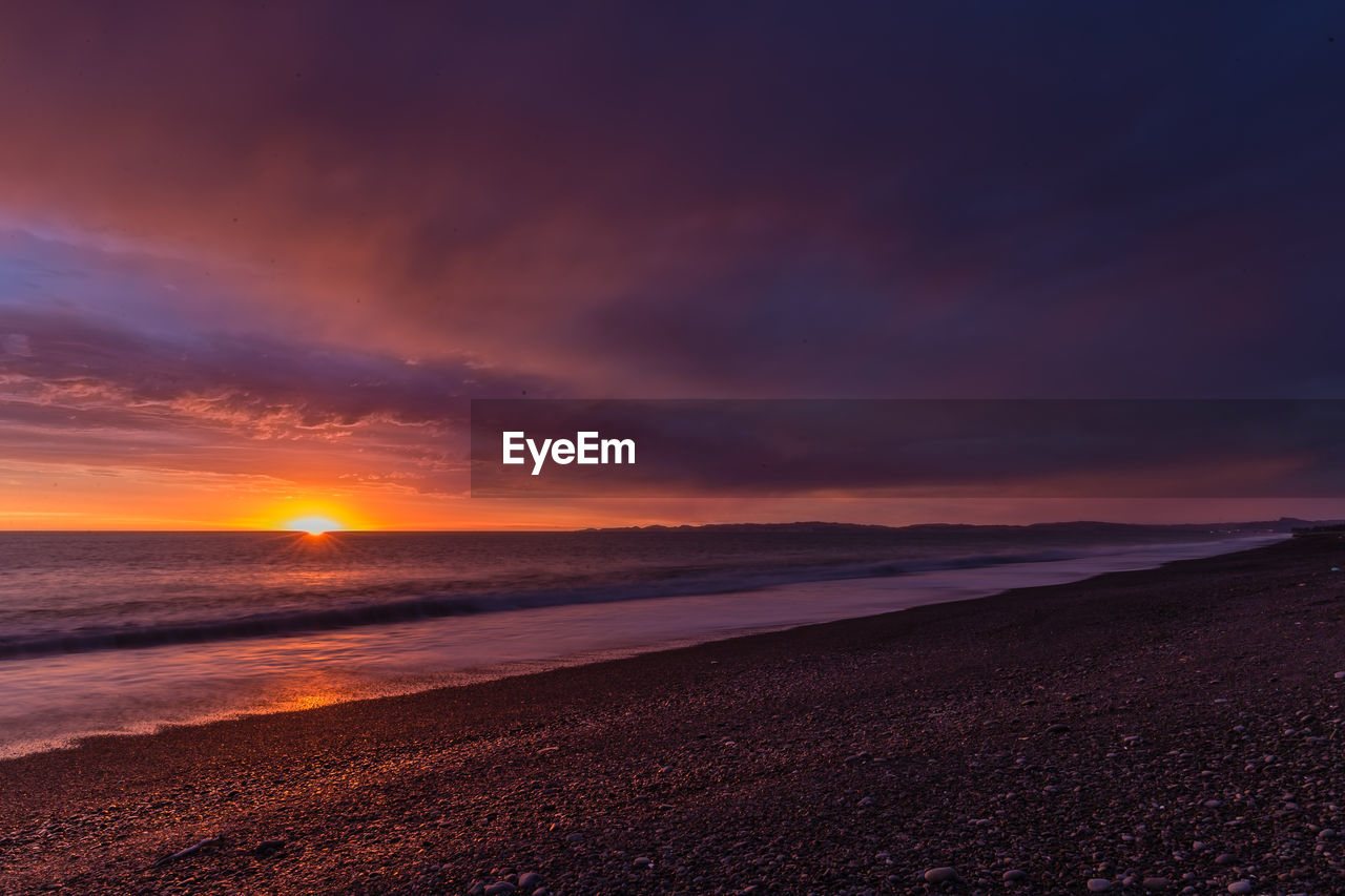 sky, sunset, scenics - nature, beauty in nature, sea, cloud - sky, tranquil scene, tranquility, water, land, horizon, beach, horizon over water, orange color, idyllic, no people, non-urban scene, nature, sun, outdoors