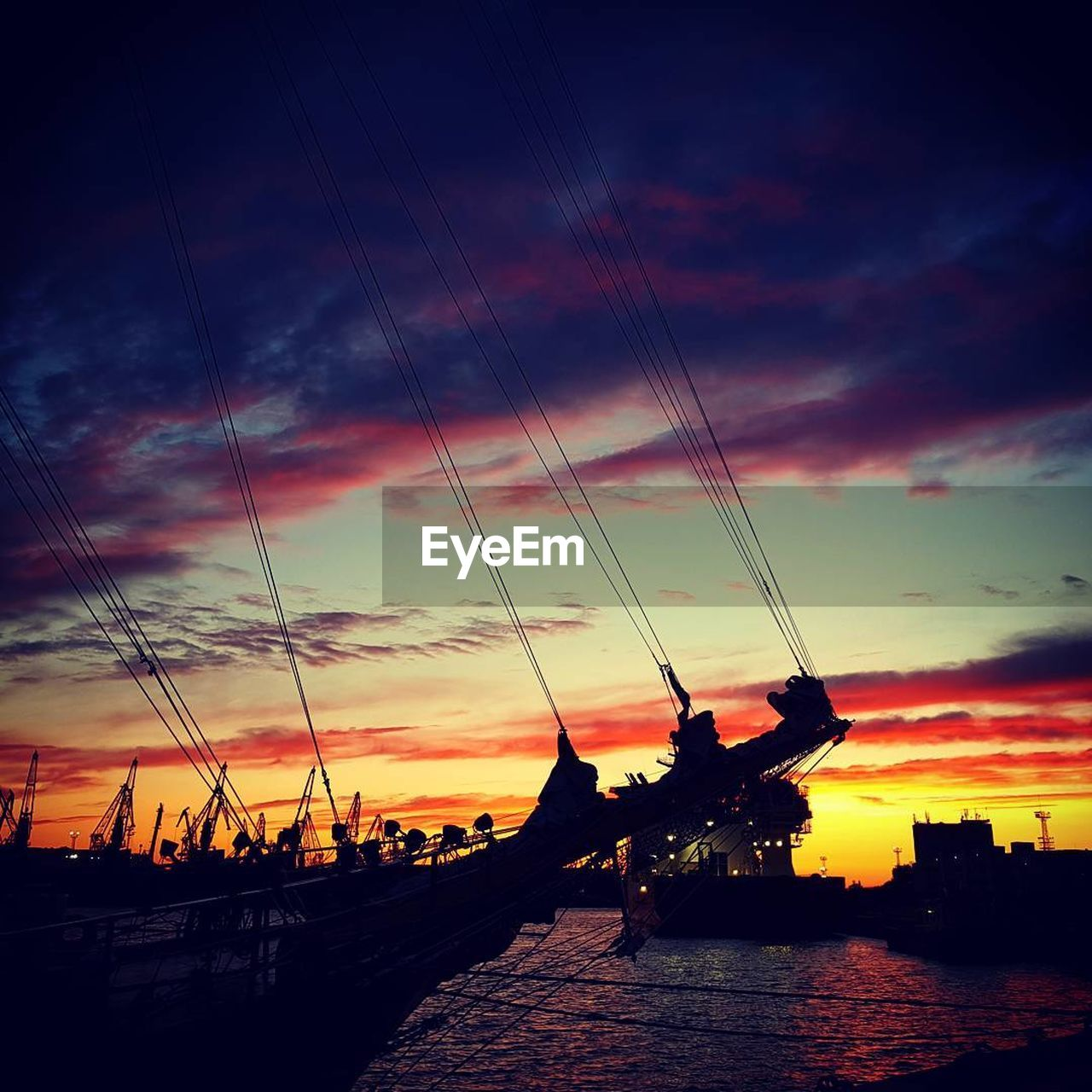 sunset, cloud - sky, silhouette, sky, dramatic sky, nautical vessel, transportation, water, nature, dusk, river, scenics, beauty in nature, outdoors, built structure, building exterior, travel destinations, architecture, no people, city, day