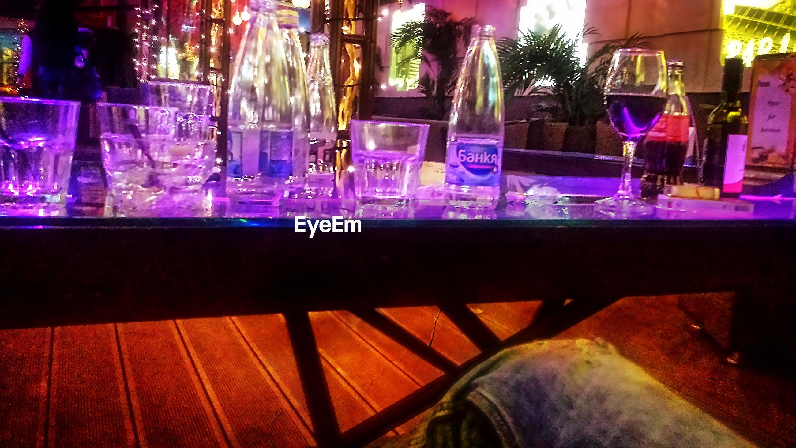 bar - drink establishment, table, bar, night, bar counter, alcohol, illuminated, nightclub, indoors, no people