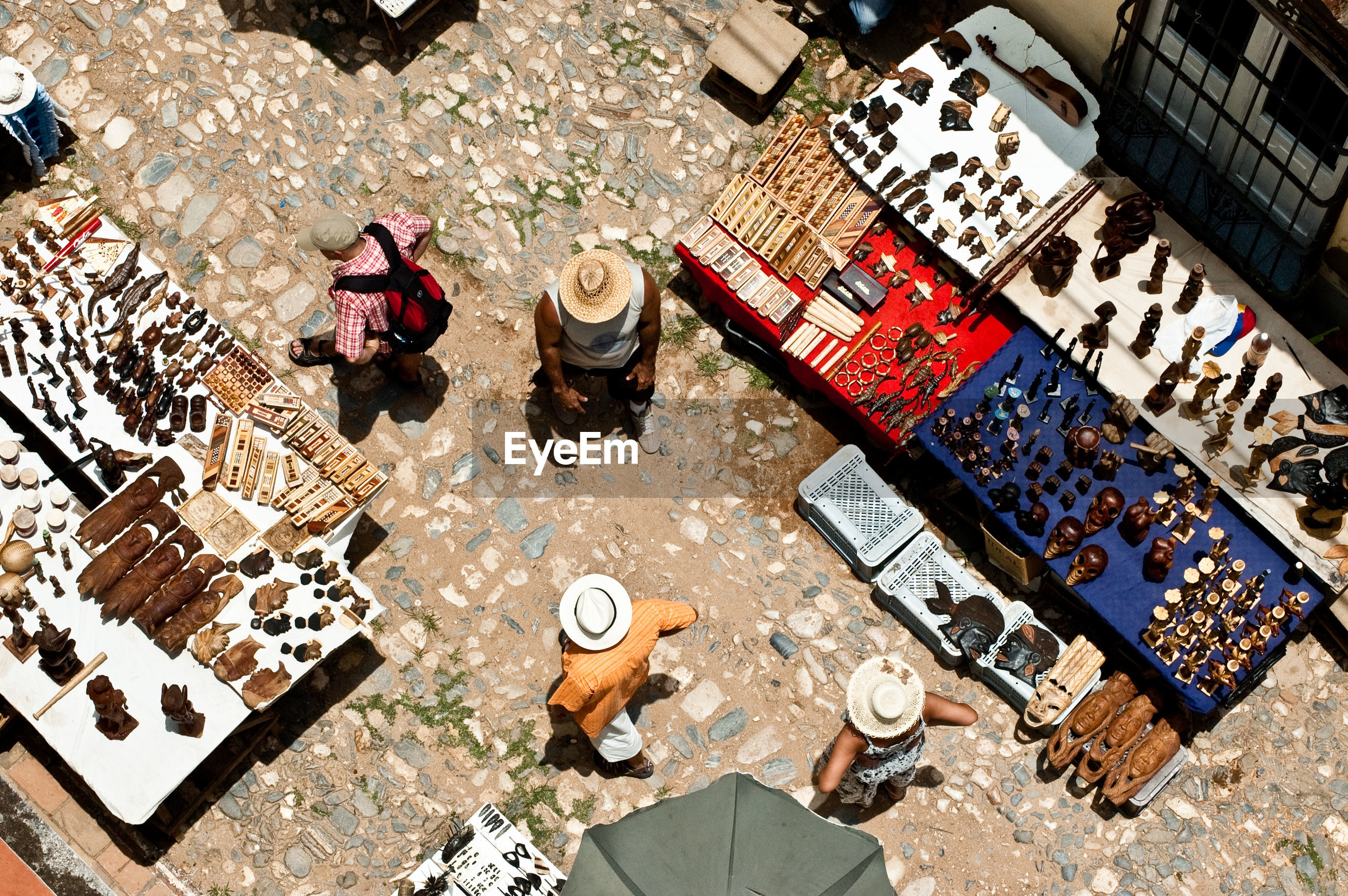 Overhead view of people and market stall on street