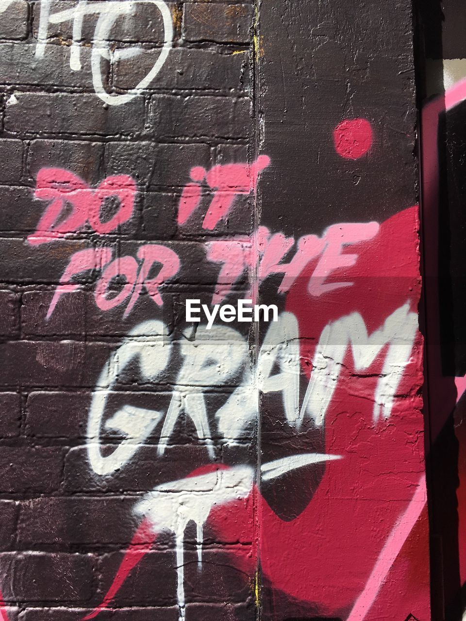 text, graffiti, western script, no people, architecture, communication, art and craft, creativity, wall - building feature, day, built structure, red, building exterior, multi colored, capital letter, outdoors, city, wall, close-up, paint, message