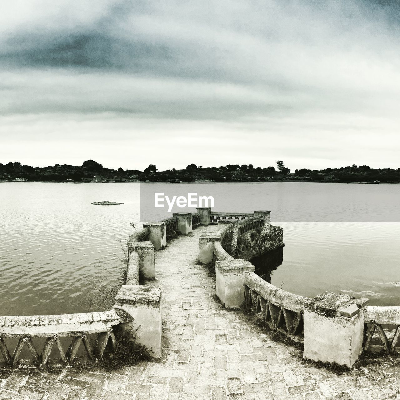 water, sky, cloud - sky, nature, lake, tranquil scene, tranquility, day, no people, scenics - nature, beauty in nature, architecture, outdoors, built structure, tree, plant, concrete