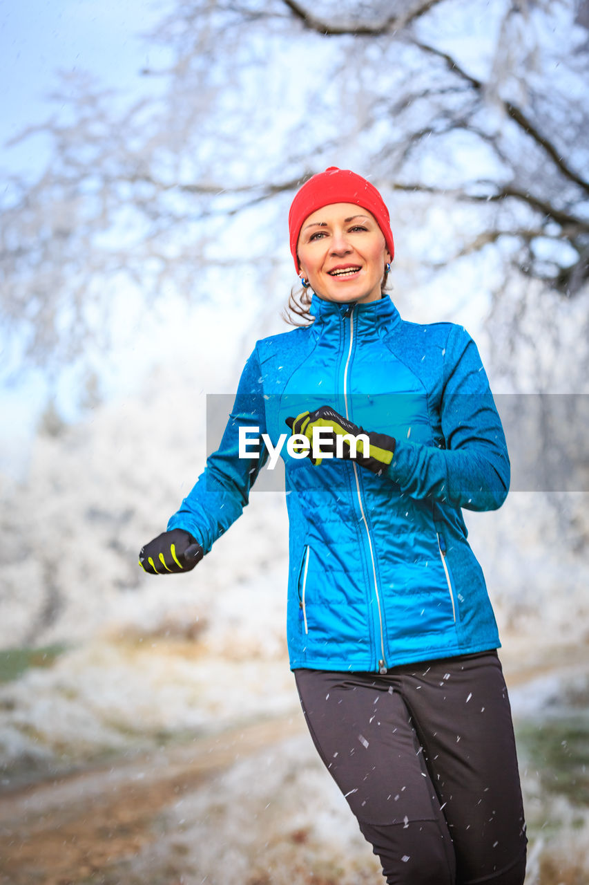 Woman Running On Field During Winter