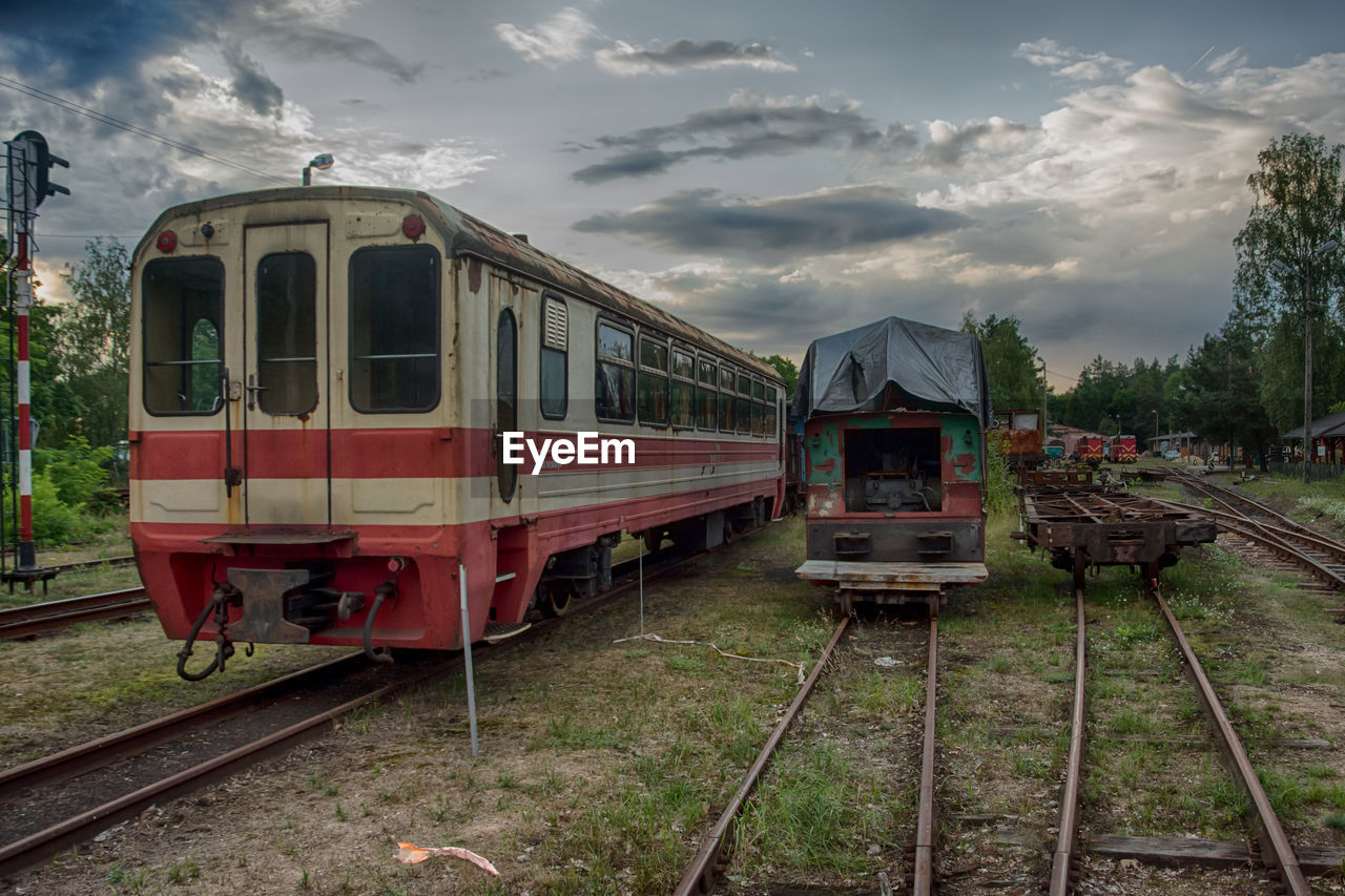 rail transportation, track, railroad track, public transportation, train, mode of transportation, transportation, train - vehicle, cloud - sky, sky, land vehicle, nature, day, travel, no people, outdoors, on the move, passenger train, abandoned, old, shunting yard, railroad car