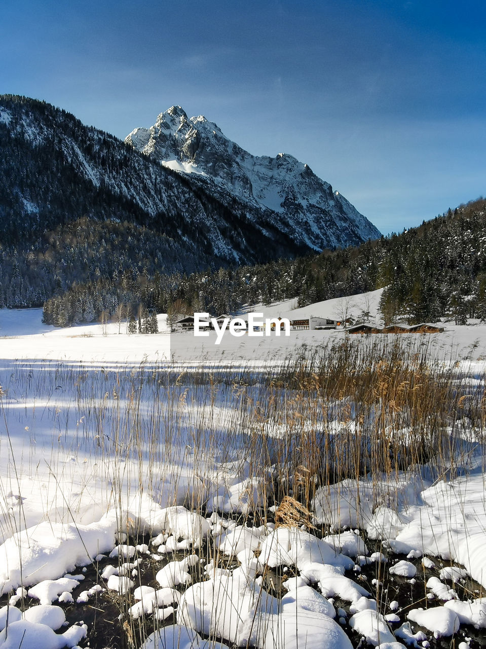 View to wetterstein in the bavarian alps from frozen lautersee near mittenwald