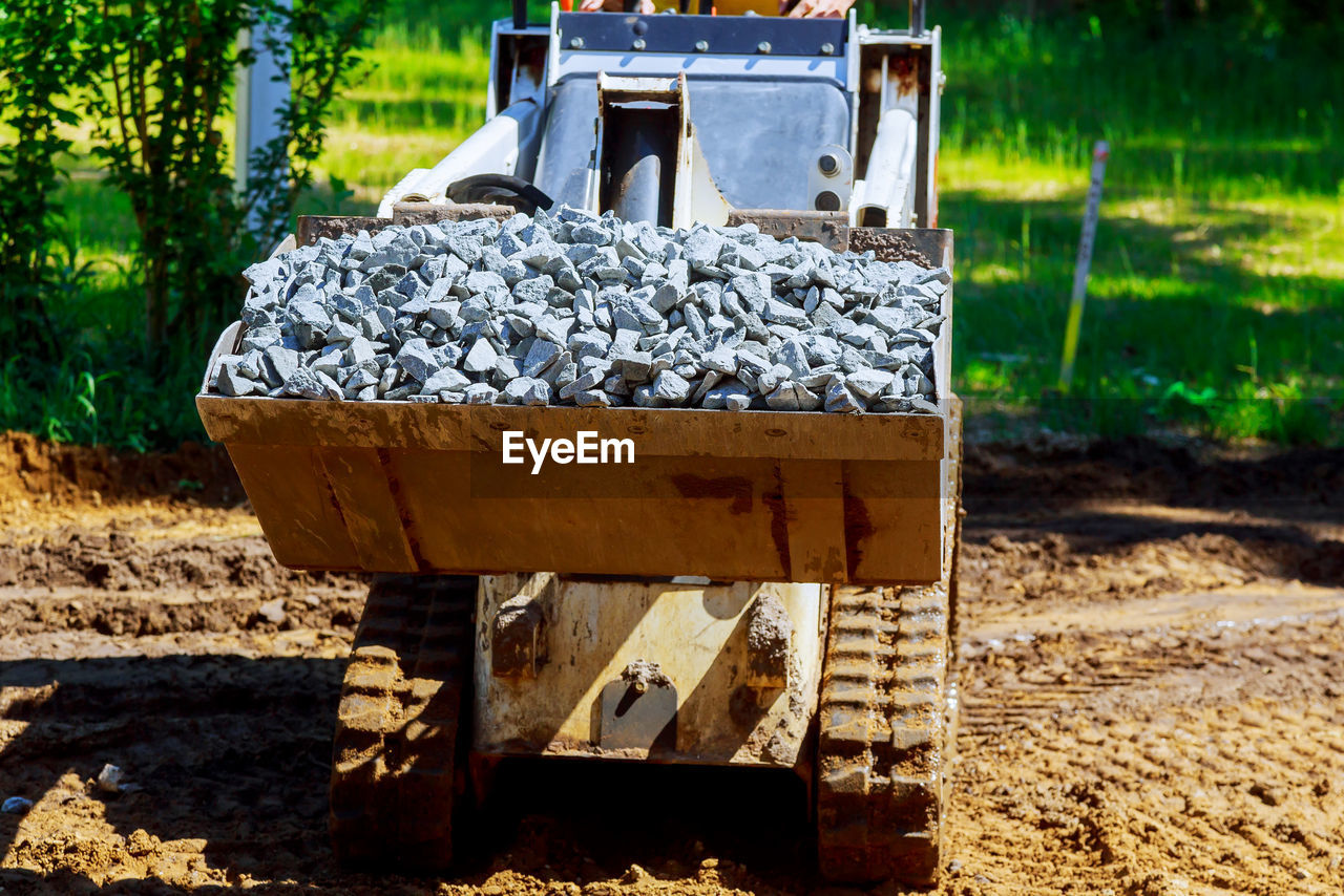 focus on foreground, nature, day, container, sunlight, no people, outdoors, land, transportation, field, solid, close-up, plant, dirt, wood - material, technology, box, machinery, industry, mode of transportation