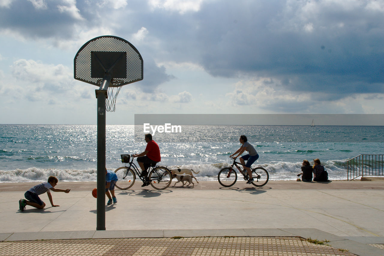 BICYCLE ON SEA BY ROAD AGAINST SKY