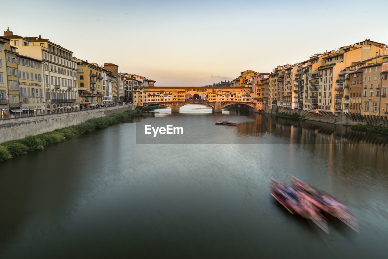 Ponte Vecchio Over Arno River During Sunset In City