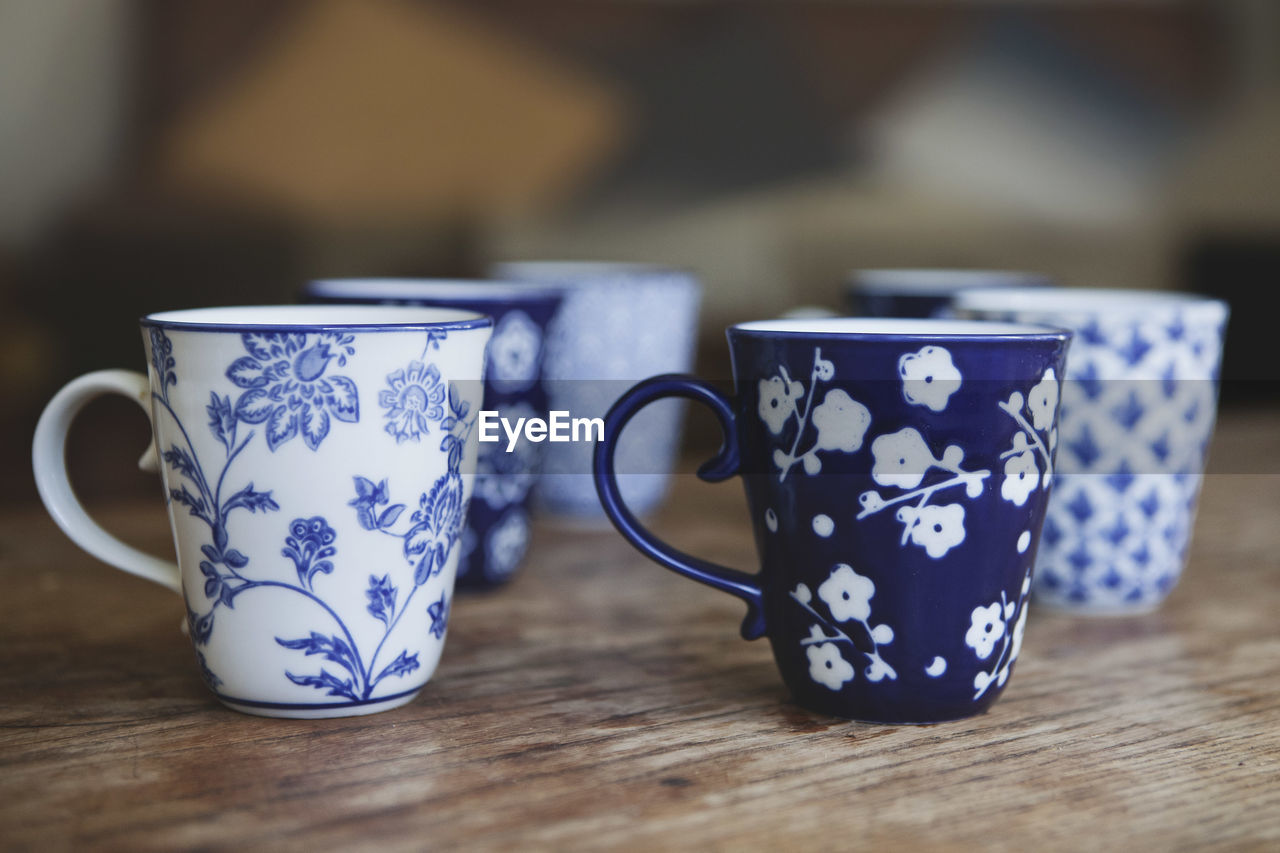 Close-Up Of Coffee Cups On Table