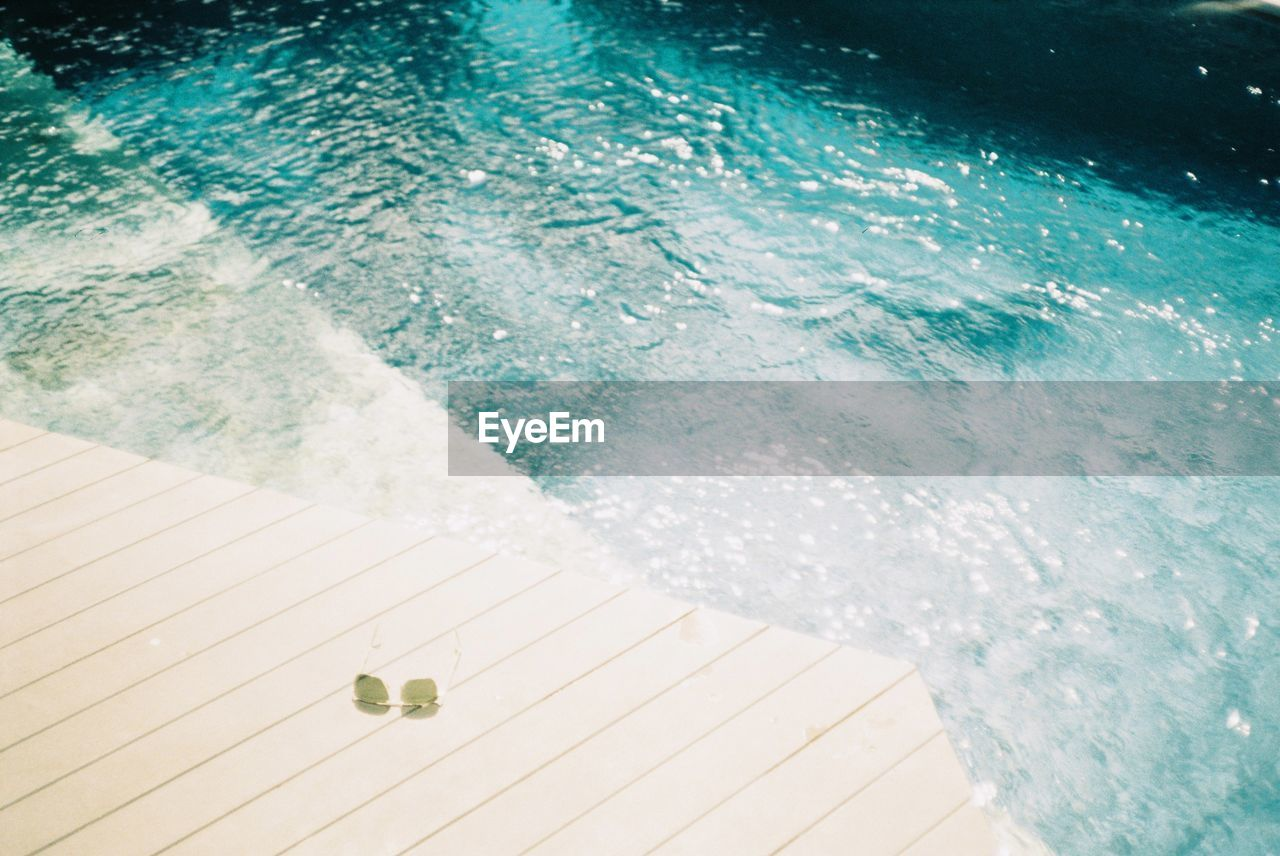 water, sea, nature, swimming pool, motion, pool, high angle view, day, no people, outdoors, wave, sport, aquatic sport, summer, beauty in nature, sunlight, wood - material, refreshment, turquoise colored, power in nature