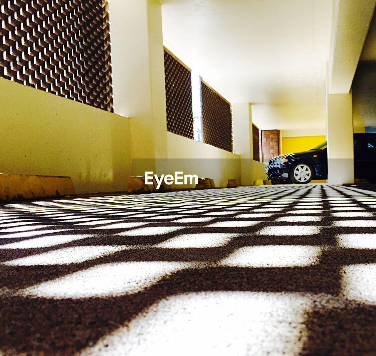 architecture, built structure, indoors, sunlight, shadow, car, transportation, day, no people