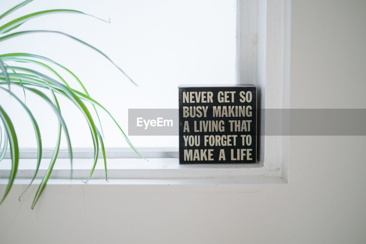 Text on window sill by wall