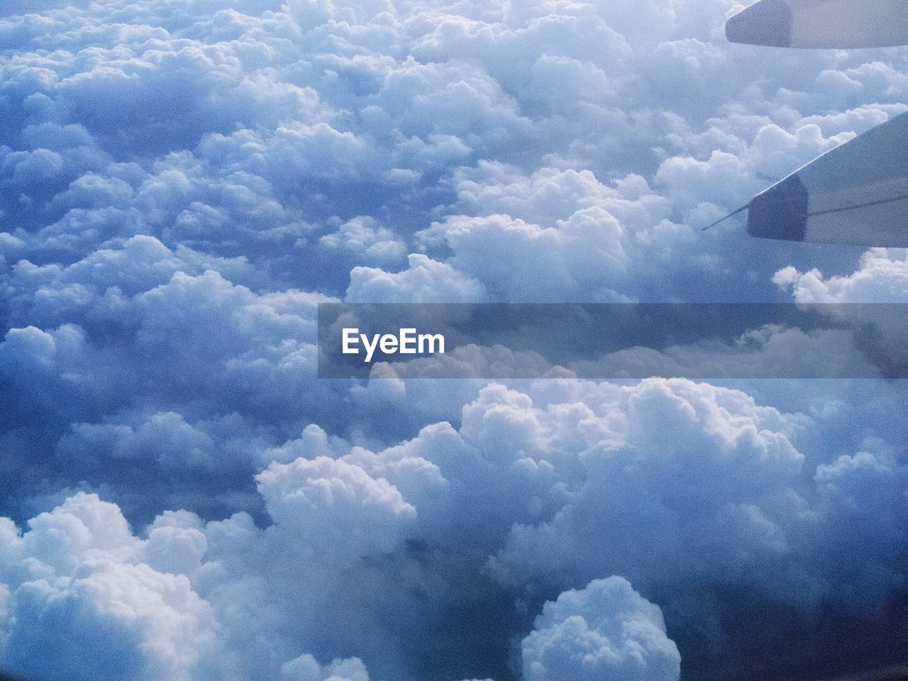 cloud - sky, nature, cloudscape, sky, beauty in nature, majestic, scenics, aerial view, outdoors, no people, day, journey, backgrounds, blue, airplane, transportation, travel, tranquility, airplane wing