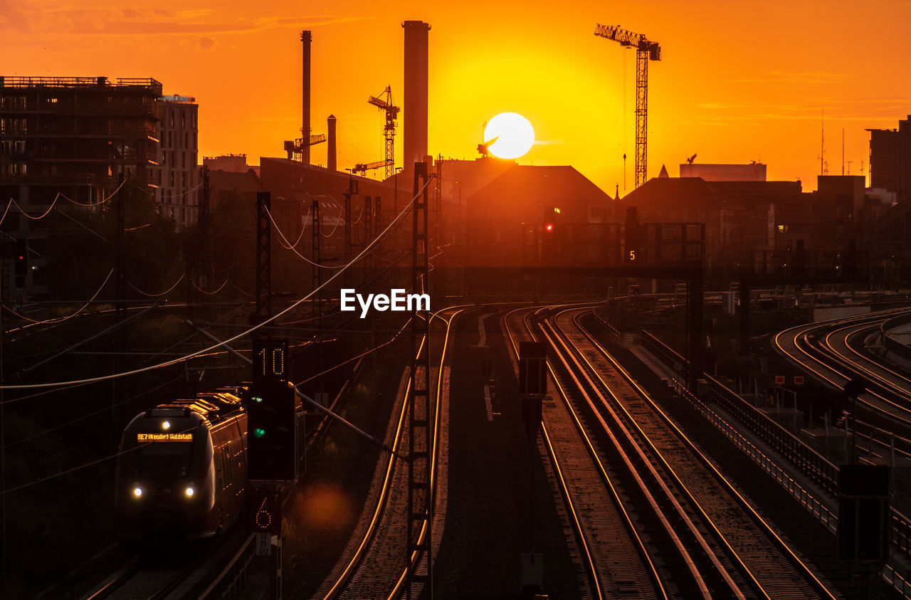 High Angle View Of Train On Railroad Track During Sunset