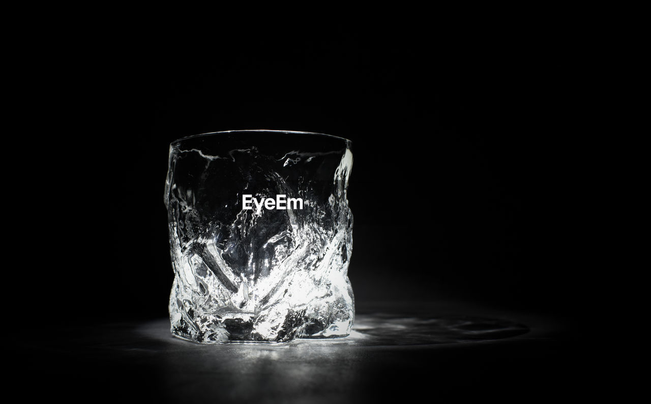indoors, black background, studio shot, transparent, copy space, no people, frozen, still life, ice, table, cold temperature, glass, glass - material, single object, drinking glass, close-up, ice cube, water, nature