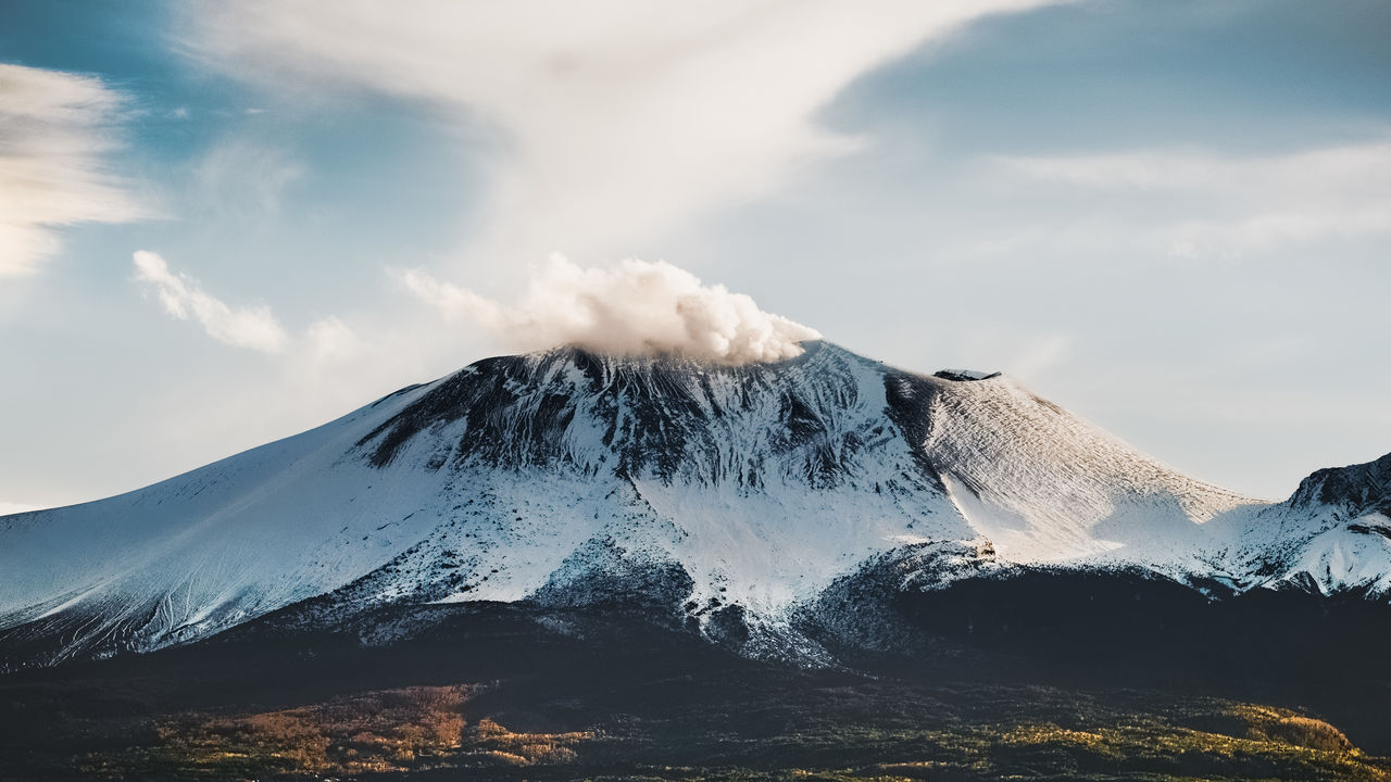 Scenic view of snowcapped volcano against sky