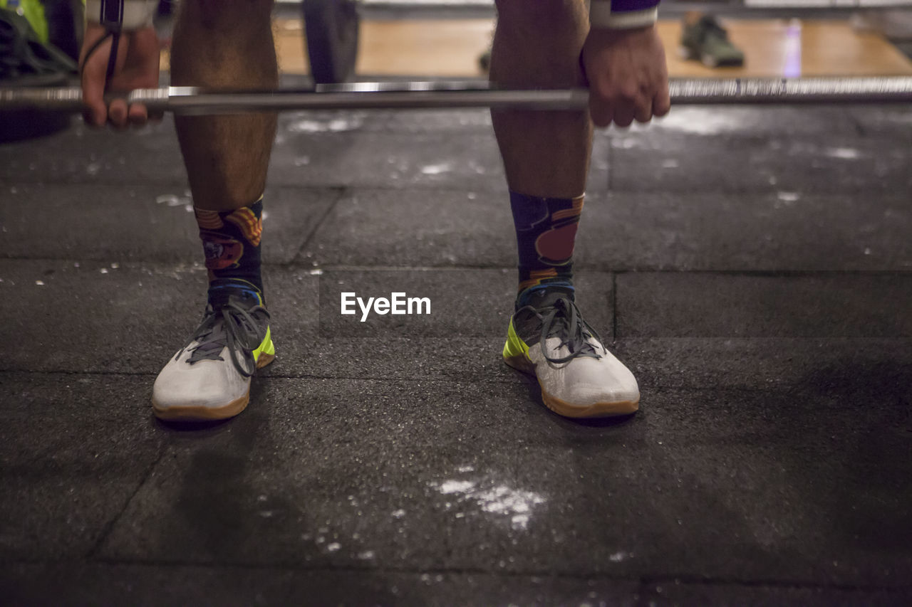 low section, human body part, body part, human leg, real people, sport, lifestyles, shoe, one person, leisure activity, unrecognizable person, day, skill, selective focus, sports equipment, city, motion, balance, human foot, human limb