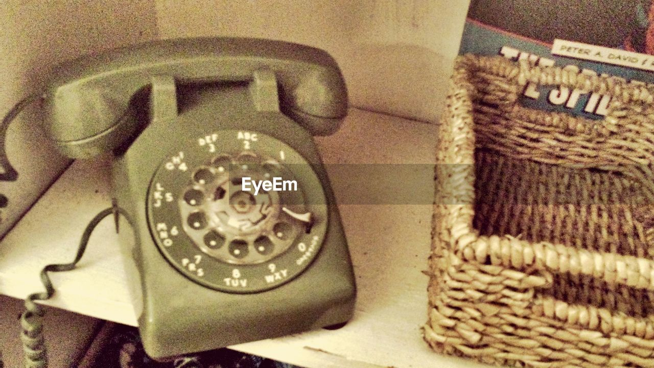 old-fashioned, communication, telephone, retro styled, rotary phone, connection, telephone receiver, landline phone, table, indoors, technology, close-up, antique, no people, day