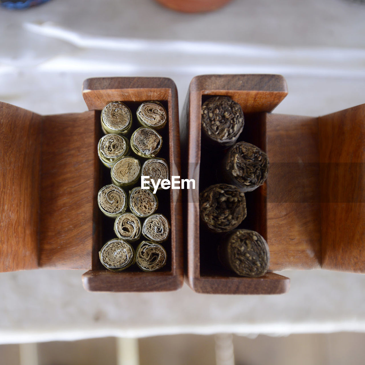 Directly Above Shot Of Weed In Wooden Container