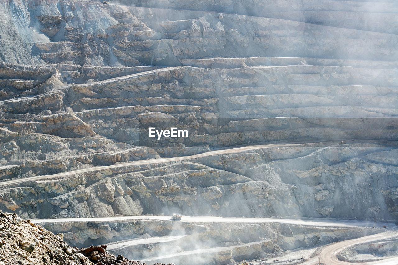 Full frame shot of open-pit mine on sunny day