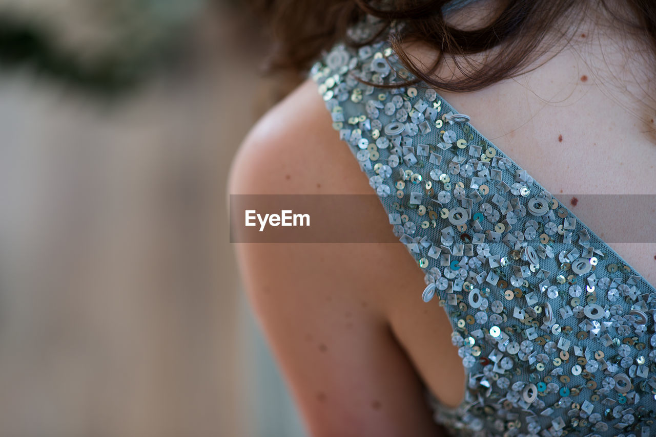 Close-up of young woman wearing sequin dress