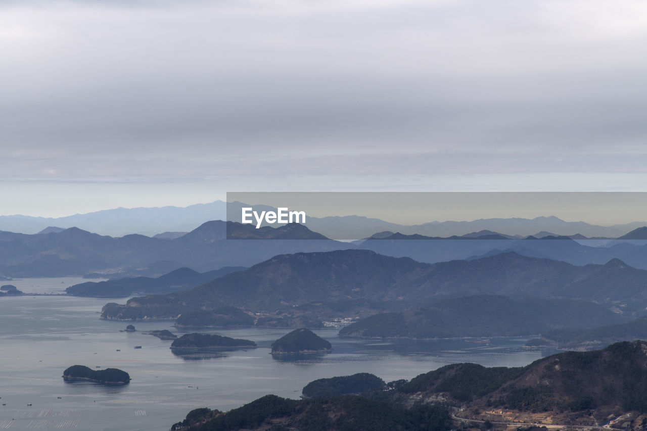 mountain, scenics - nature, tranquil scene, beauty in nature, tranquility, sky, cloud - sky, mountain range, no people, non-urban scene, idyllic, environment, nature, fog, outdoors, landscape, day, remote, water, mountain peak